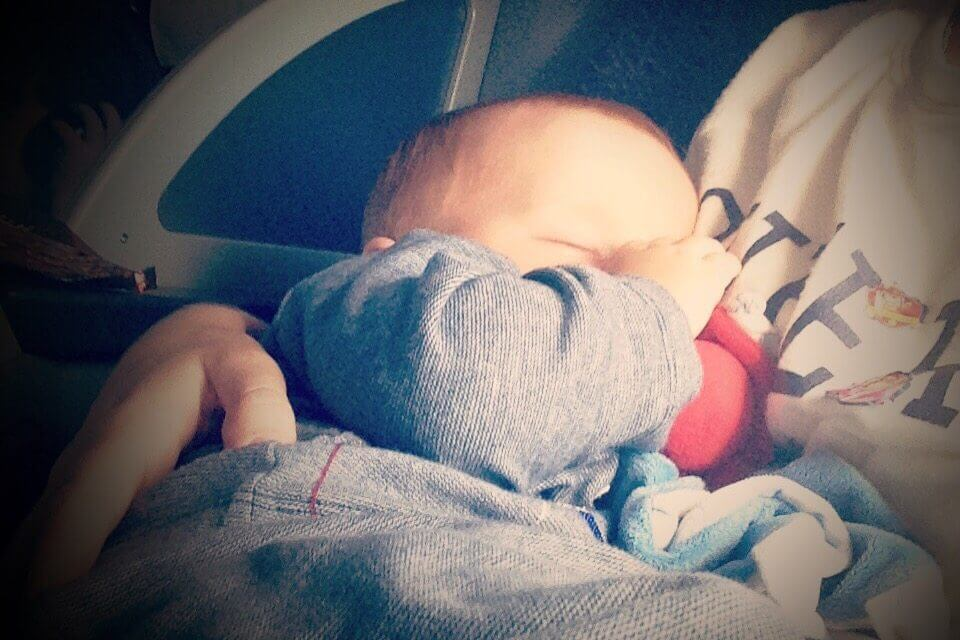 Tips for surviving a long-haul flight with a lap baby